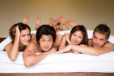 two couples in bed Why Choose Polyamory?