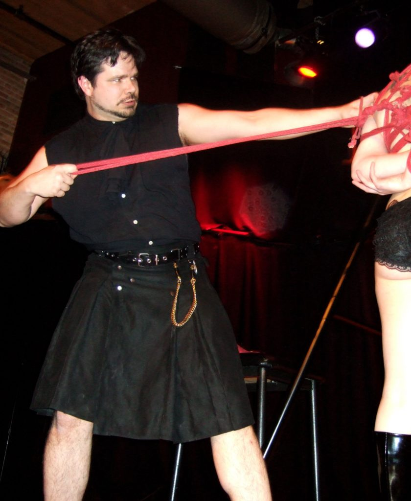 Graydancer in a kilt with rope